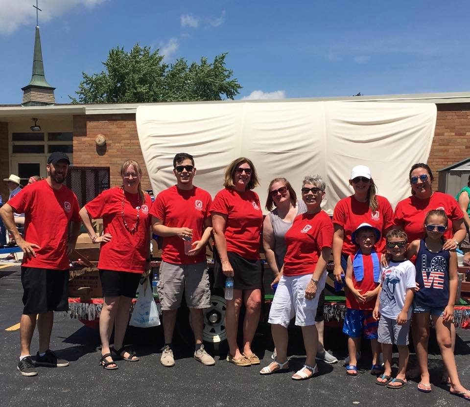 The State Bank Group staff members with 2018 parade float
